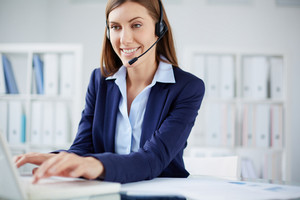 Young Businesswoman With Headset Consulting Clients Online
