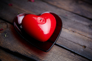 Image Of Red Heart Shaped Candle On Wooden Background