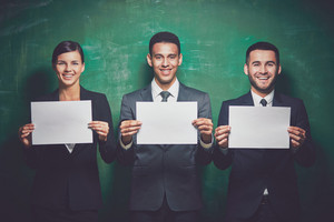 Elegant Business Partners With Blank Papers Looking At Camera On Green Background
