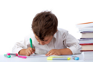 Portrait Of School Boy Drawing Picture On Paper