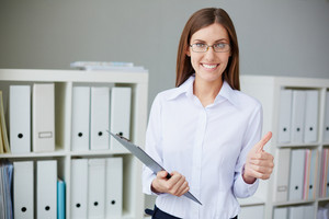 Young Businesswoman With Document Showing Thumb Up