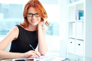 Pretty Office Lady Analyzing Financial Documents In Office