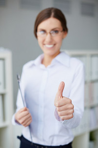 Young Businesswoman Showing Thumb Up