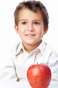 Portrait Of A Little Schoolboy With Apple
