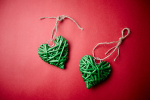 Image Of Decorative Green Hearts On Red Background