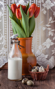 Quail Egg With Bottle Of Milk And Flowers