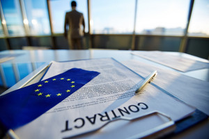 Business Contract With Pen And Flag Of European Union With Businessman On Background