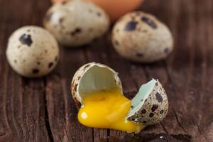 Broken Quail Egg With The Leaked Yolk