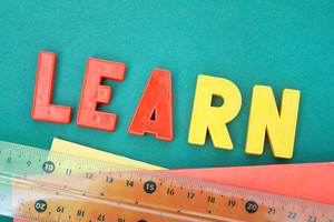 Image Of Word ‰Û÷learn‰Ûª With Copybooks And Ruler Below