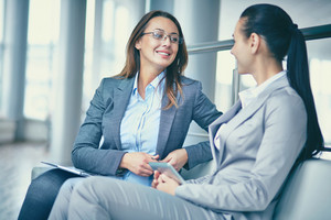 Image Of Two Confident Businesswomen Discussing New Ideas