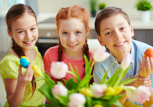 Portrait Of Three Smiling Children With Easter Eggs