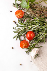 Tomatoes  Garlic And Herbs Over White