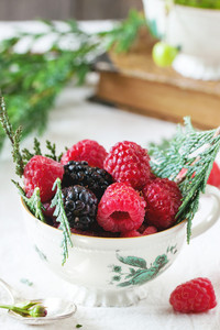 Cup Of Raspberries And Blackberries