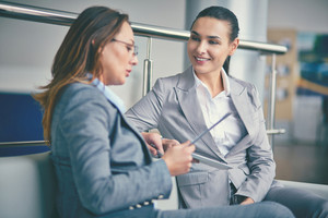 Image Of Two Confident Businesswomen Discussing Working Plan