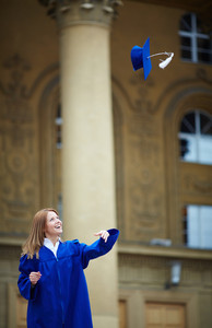 Portrait Of Joyful Student Throwing Graduation Hat