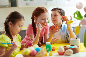 Photo Of Cute Kids Painting Easter Eggs At Home