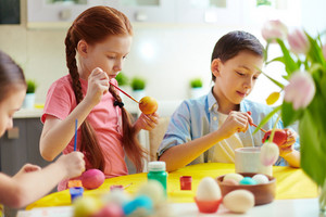 Cute Preschoolers Painting Eggs For Easter