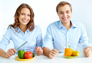 Happy Couple Eating Fresh Vegetables