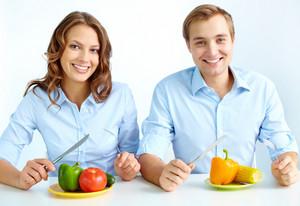 Happy Couple Eating Fresh Vegetables