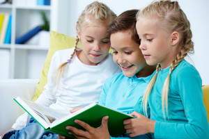Smart Schoolboy And Twin Girls Reading Book