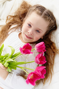 Image Of Happy Girl With Bunch Of Tulips Looking At Camera