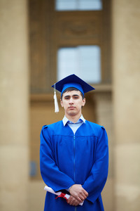 Portrait Of Confident Student With Graduation Certificate Looking At Camera