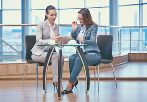 Image Of Two Friendly Businesswomen Discussing Computer Project In Office
