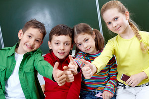 Group Of Four Classmates Showing Sign Of Ok