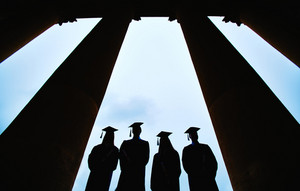 Outlines Of Four Graduates Between Columns Of University Building
