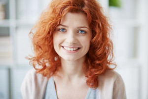 Portrait Of A Cheerful Red-haired Woman