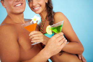 Close-up Of Cute Girl And Handsome Man With Cocktails At Beach Party