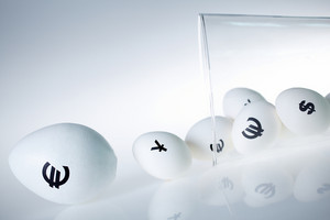 Image Of Glass Containing Eggs With Currency Signs