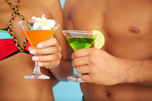 Close-up Of Cocktails In Human Hands