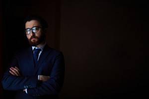 Portrait Of Elegant Businessman In Suit And Eyeglasses
