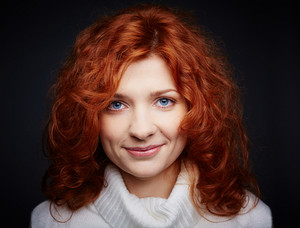Portrait Of A Woman With Red Hair Looking At Camera