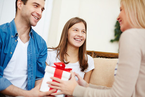 Adorable Girl And Her Father Giving Present To Blond Female