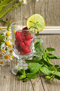 Fresh Ripe Raspberries And Camomile Flowers