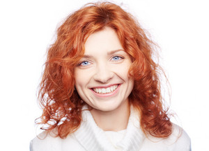Portrait Of A Ginger Woman Smiling At Camera