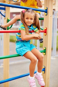 Happy Little Girl Looking At Camera On Playground Area