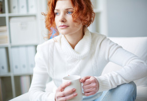 Pensive Beautiful Woman With A Cup Of Tea