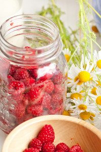 Fresh Ripe Raspberries And Camomile Flowers