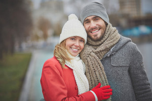 Image Of Happy Couple In Warm Clothes Looking At Camera Outside