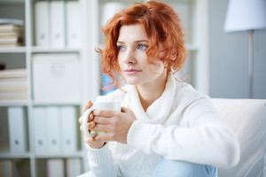 Portrait Of A Worried Woman With Cup Of Tea