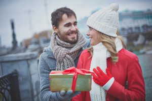 Image Of Affectionate Guy Giving Present To His Girlfriend Outside