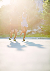 Photo Of Young Couple Running On Sunny Morning Outdoors