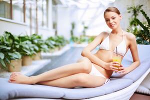 Young Girl Lying At Swimming Pool