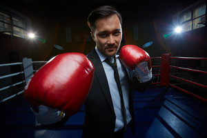Strong And Confident Businessmen In Suit And Boxing Gloves Looking At Camera
