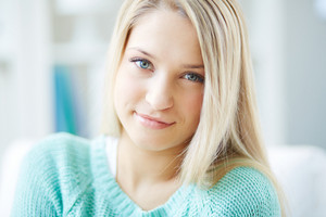 Portrait Of A Blond Girl With A Flirty Look