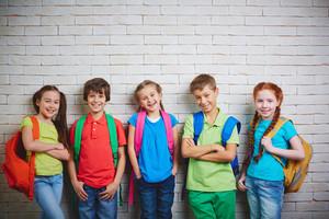 Group Of Cute School Friends In Casualwear Looking At Camera
