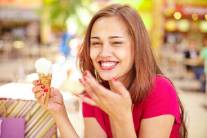 Smiling Girl Eating An Ice-cream Scoop In A Waffle Cone